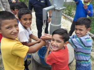 Childrens washing their hands