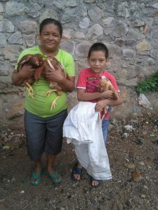 Diana America Sarmiento with her Children and their Hens
