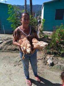 Donilda Peña Garcia with her Hens