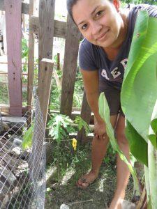 Beneficiary with a paupau tree