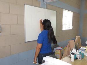 Teacher writing on the whiteboard