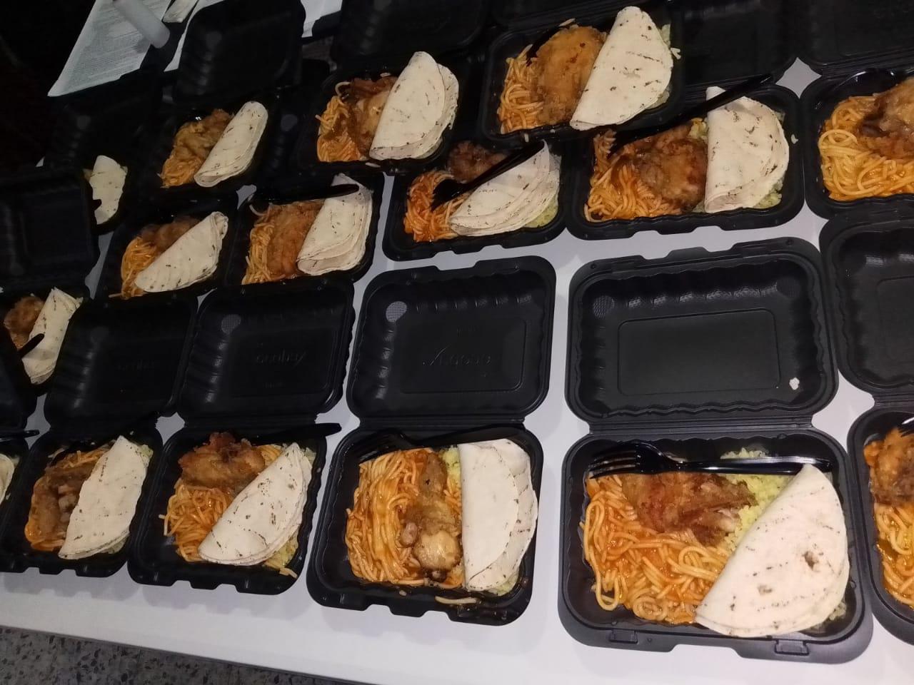 Donación de almuerzos en la Carretera hacia la Lima,Cortes.